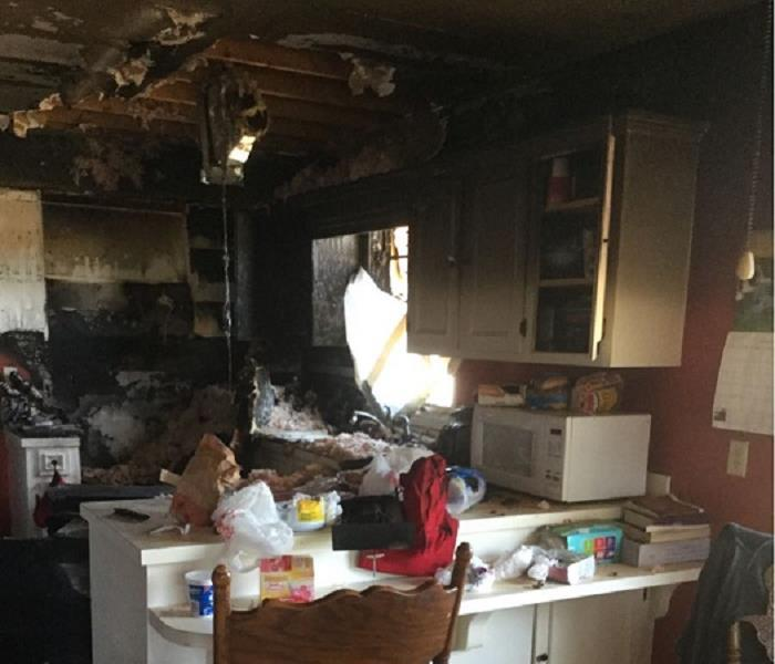 Burned kitchen with fallen insulation
