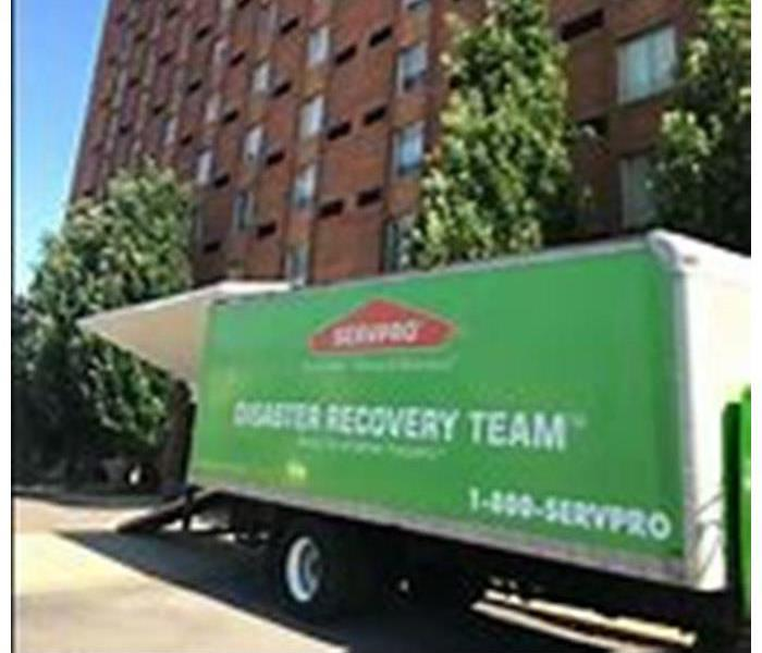 Disaster Recovery Team semi in front of a commercial building