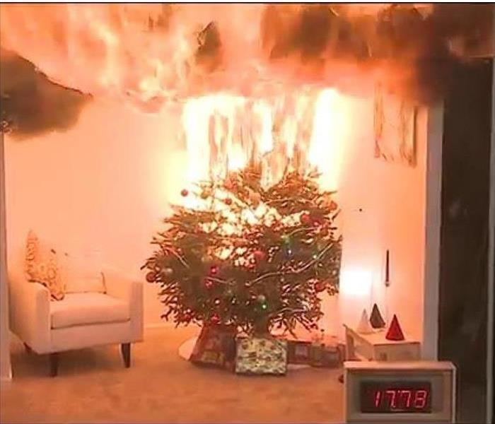 A christmas tree set ablaze from defective lights.